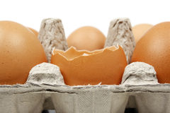 Broken egg in eggbox Stock Photography
