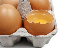 Broken egg in eggbox Stock Photo