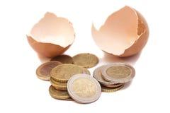 Broken egg with euro coins Royalty Free Stock Photos