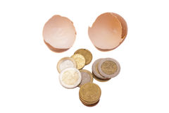 Broken egg with euro coins. Isolated Stock Photography