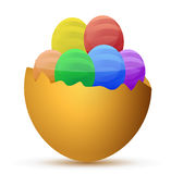 Broken egg filled with little chocolate eggs Royalty Free Stock Photos
