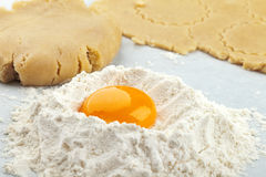 Broken egg on flour Royalty Free Stock Photo