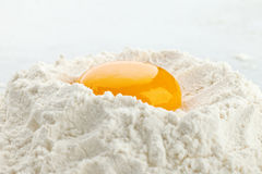 Broken egg on flour Stock Photography