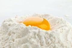 Broken egg on flour Stock Photography