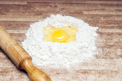 Broken egg on flour Stock Images