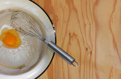 Broken egg in flour Stock Photos