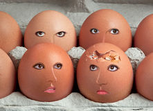 Broken egg with friends Royalty Free Stock Images