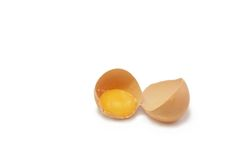 Broken egg in half Royalty Free Stock Photography
