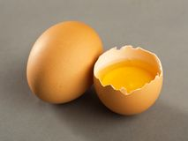 Broken egg isolated on gray background Stock Photos