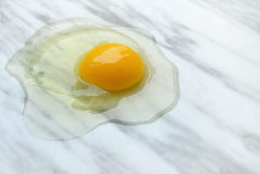 Broken egg. On marble background Royalty Free Stock Photography