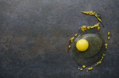 Yellow yolk and mustard beans on black table,top view stock photos