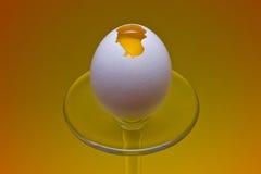 Broken egg. A broken egg over a cristal platform Royalty Free Stock Photos