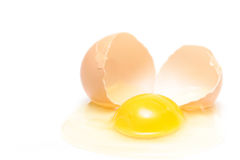 Broken egg over white Stock Image