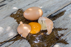 Broken egg on a wooden Royalty Free Stock Photography