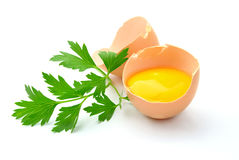 Broken egg yolk with a bright Royalty Free Stock Photo
