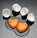 Broken egg and yolk. Broken egg and yolk with heart shape Royalty Free Stock Photo