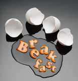 Broken egg and yolk. With text  Breakfast Royalty Free Stock Images