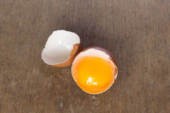 Broken egg. With yolk on wood Stock Photo