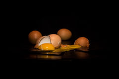 Broken eggs. In black background royalty free stock images