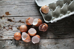 Broken eggs, egg shells in the carton, baking and cooking. Preparation Stock Images