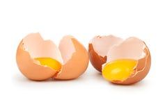 Broken eggs. Isolated on white background stock photos