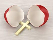 Broken eggshell and cross Stock Image