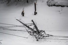 Broken electricity pole because of sleet Stock Photography