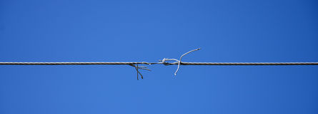 Broken electric wire. Picture of a Broken electric wire Stock Images