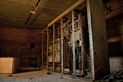Broken electrical cabinets in abandoned factory royalty free stock images