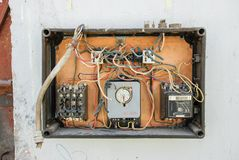 Broken electrical panel of abandoned factory. Destroyed electrical panel of abandoned factory stock image