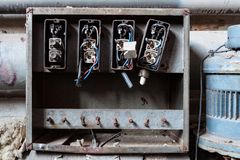 Broken electrics in abandoned fatory. Broken electrics box in abandoned fatory stock image