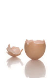 Broken empty egg shell on white Stock Photo