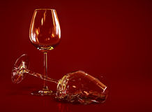 Broken Empty Wine Glass. On dark red background Stock Illustration