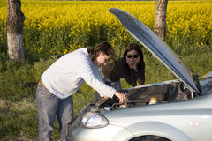 Broken engine. Man and woman looking on the broken engine Royalty Free Stock Photo