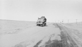 Broken expeditionary truck covered with snow on an arctic road Stock Photography