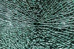 Broken exponeringsglas på en svart bakgrund Arkivfoton