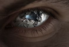 Broken eye and glass. Surreal image of an eye broken with glass royalty free stock photography