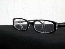 Broken eye glasses Stock Photos