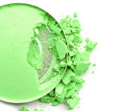 Broken eye shadow green color close up circle box. royalty free stock photos