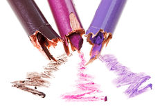 Broken eye shadow pencil with stroke samples stock images