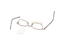 Broken eyeglasses. Isolated on a white background Stock Images