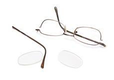Broken eyeglasses. Isolated on a white background Royalty Free Stock Image