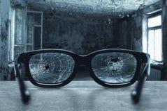 Broken eyeglasses Stock Photos