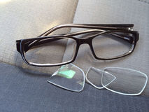 Broken eyeglasses. Pair of Broken eye glasses royalty free stock images