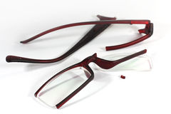 Broken eyeglasses. On the white background Stock Photo