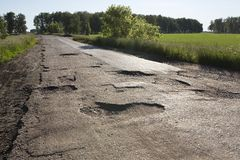 Broken fabric of rural roads in Omsk region Stock Photo