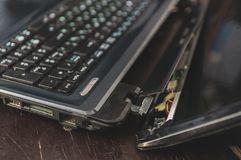 Broken and fallen laptop, defective laptop. Laptop non-working, with a crack and breakage, torn screen royalty free stock photos