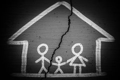 Broken Family. A family picture with a crack which means Broken Family Concept Stock Image
