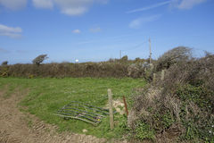 Broken Farm Gate Cornwall England. Broken Farm Gate and field in South Cornwall England stock photo