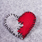 Broken felt heart Stock Photo